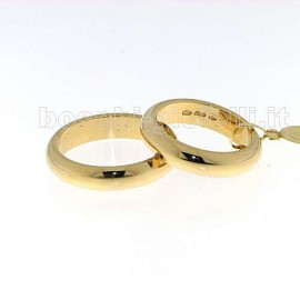 WEDDING RING IN GOLD 18k GR.10,0 HEIGHT 5mm.<BR>Weights and carat are indicative and they are subject to change depending on the ring size. Contact us for a personalized quote.